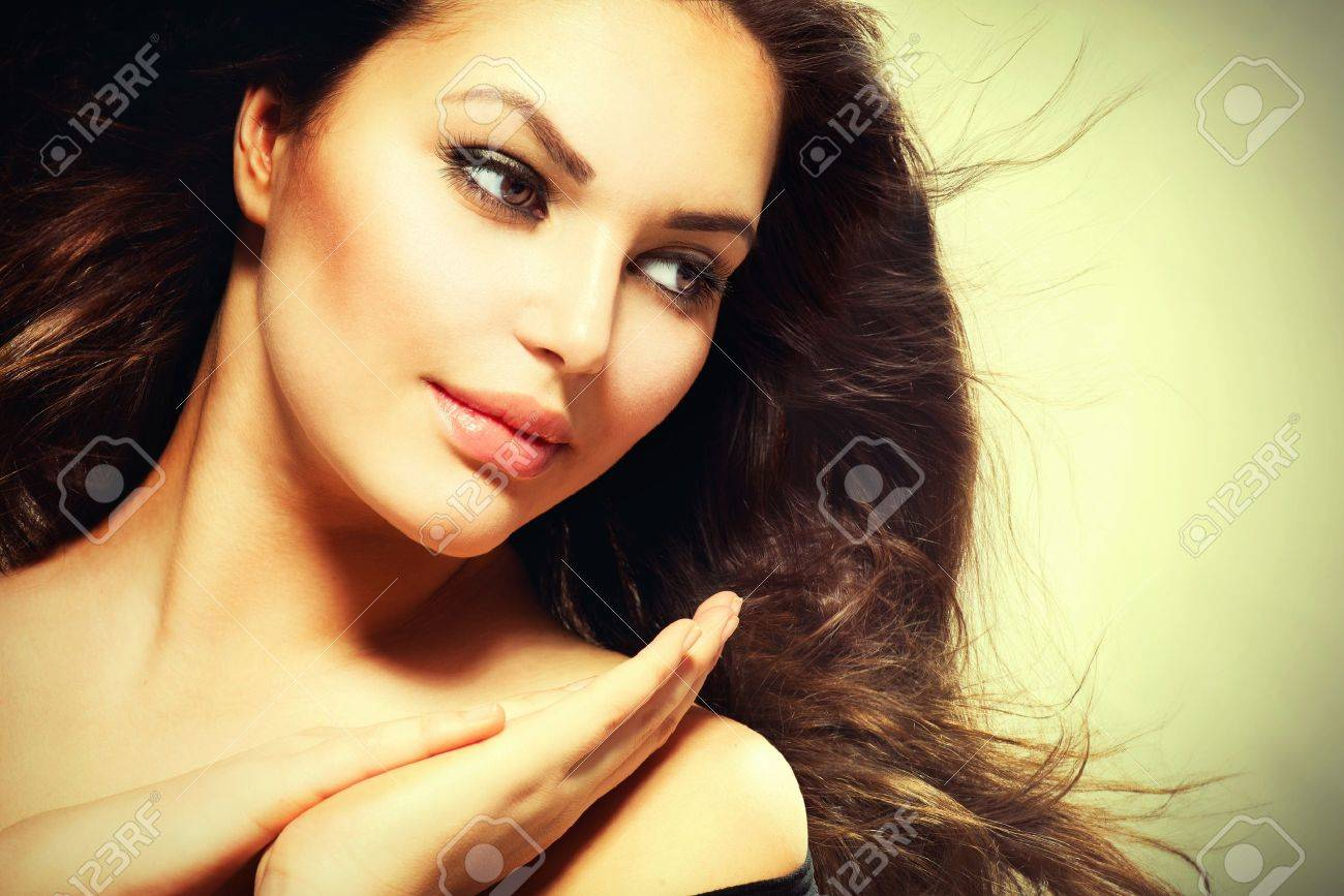 Beautiful Brunette Woman with Blowing Healthy Hair Stock Photo - 20793566