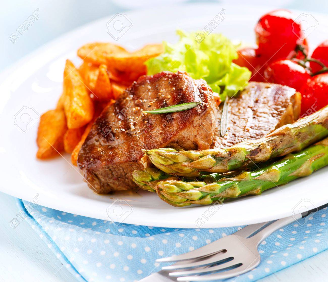 Grilled Beef Steak Meat With Fried Potato Asparagus Tomatoes Stock Photo 20793572