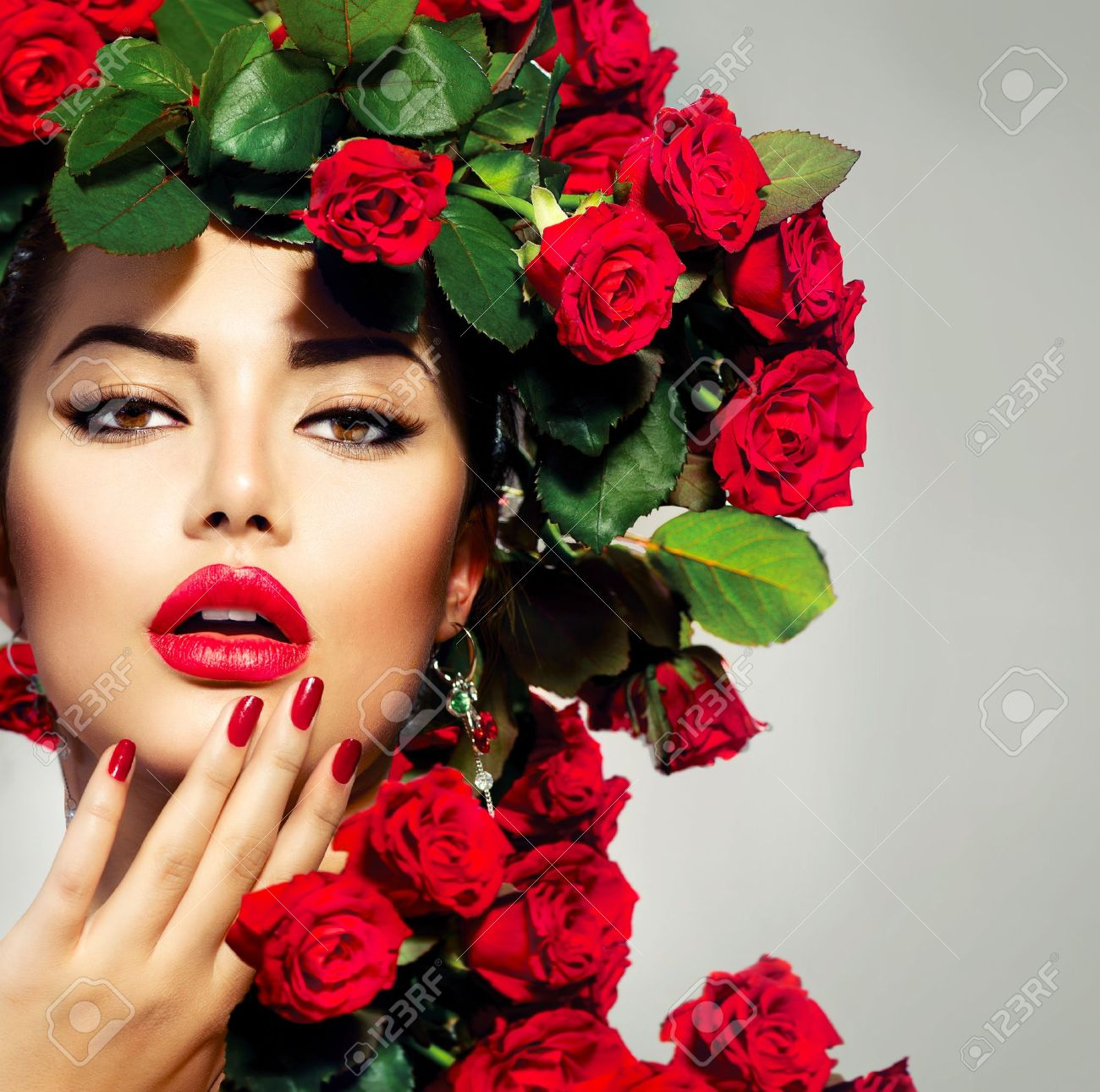 Beauty Fashion Model Girl Portrait with Red Roses Hairstyle Stock Photo - 20793584