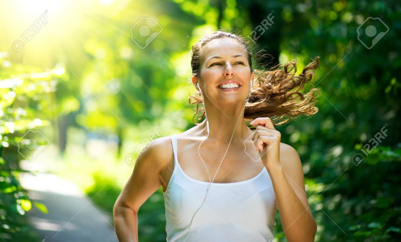 Running woman  Outdoor Workout in a Park Stock Photo - 20934472