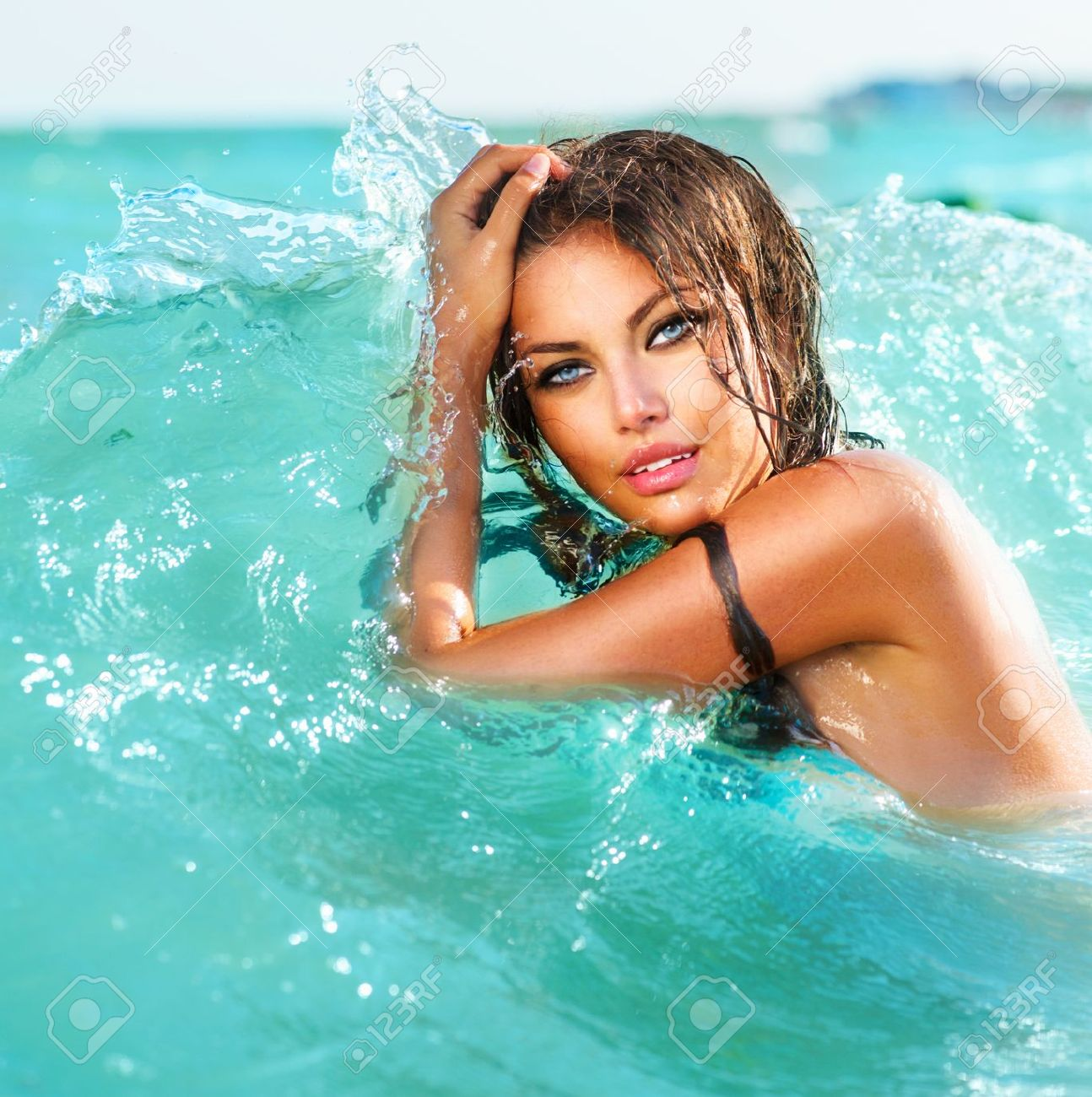 Beauty Sexy Model Girl Swimming And Posing In The Water Stock ...