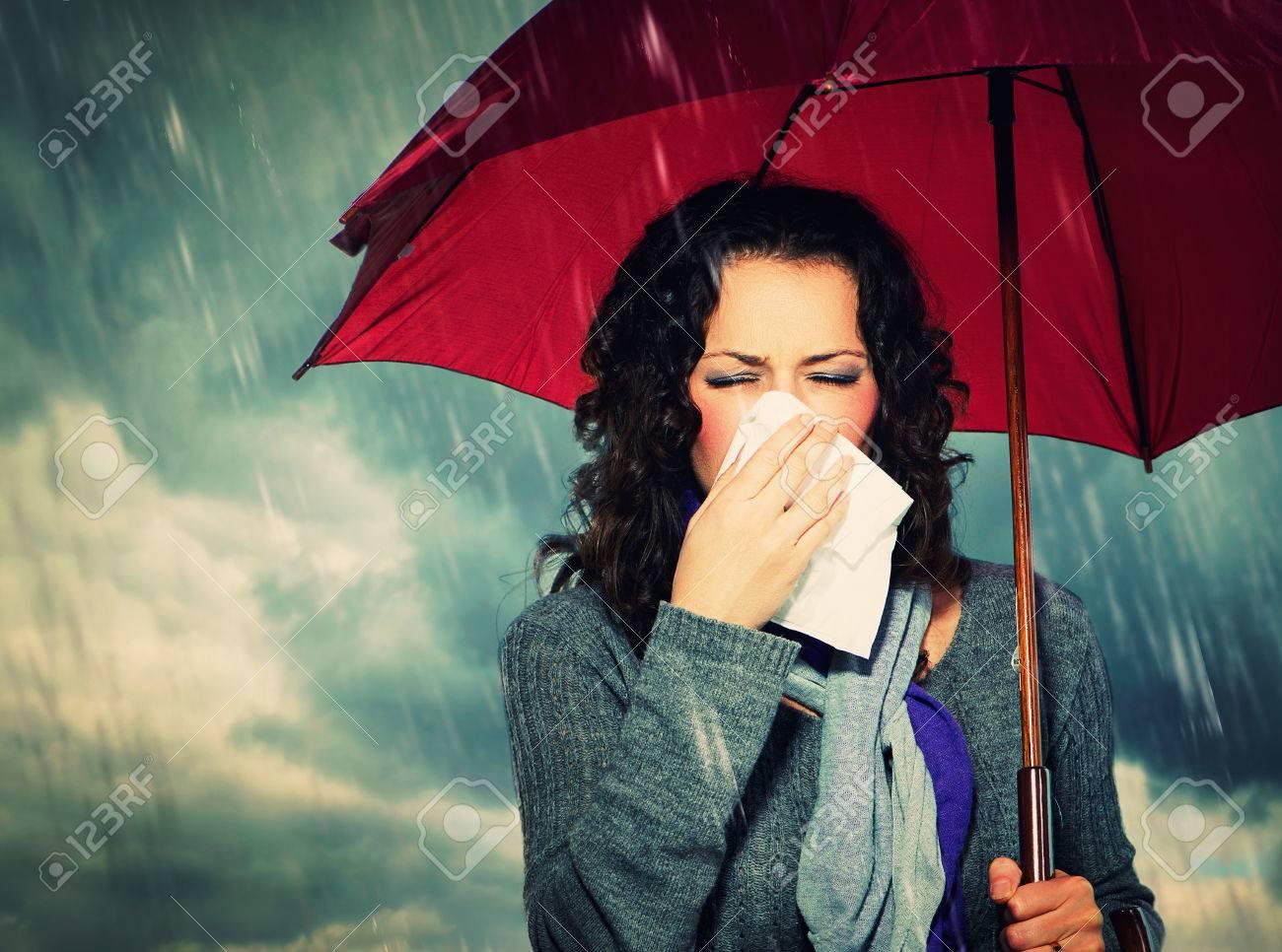 e248be6f77548 Sneezing Woman with Umbrella over Autumn Rain Background Stock Photo -  22783587
