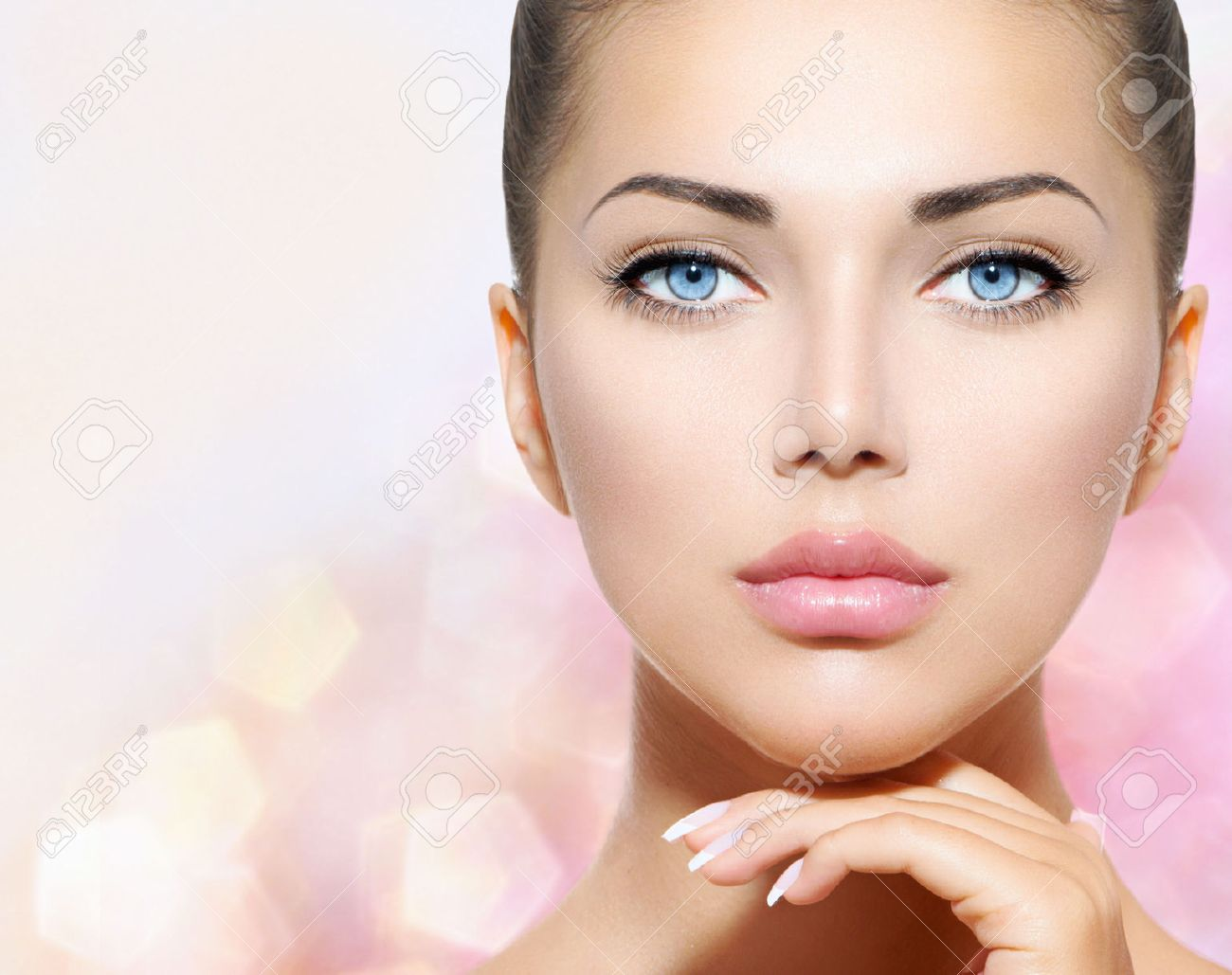 Beauty Portrait  Beautiful Spa Woman Touching her Face Stock Photo - 22997360