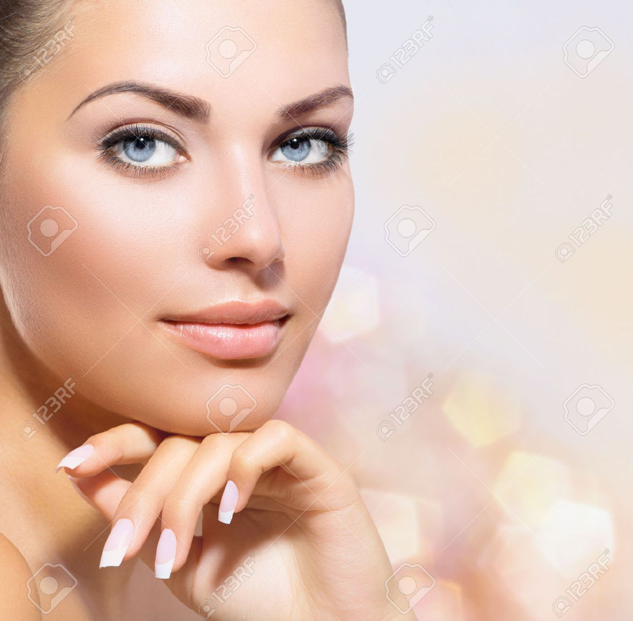 Beauty Portrait  Beautiful Spa Woman Touching her Face Stock Photo - 23735972