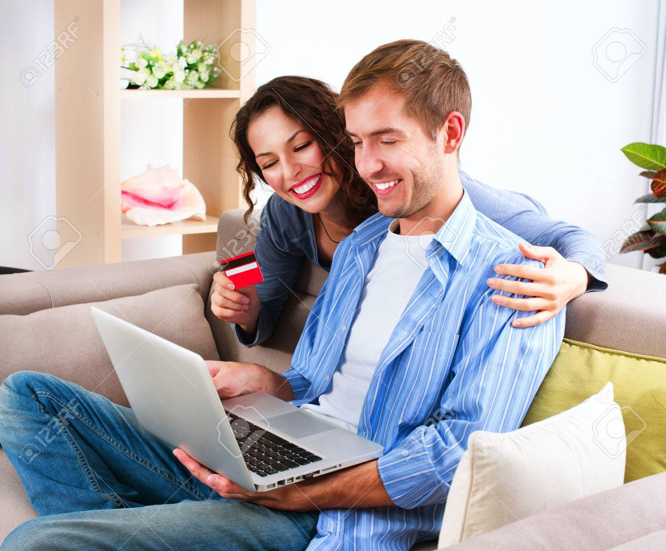 Online Shopping  Happy Couple Using Credit Card to Internet Shop Stock Photo - 24331802