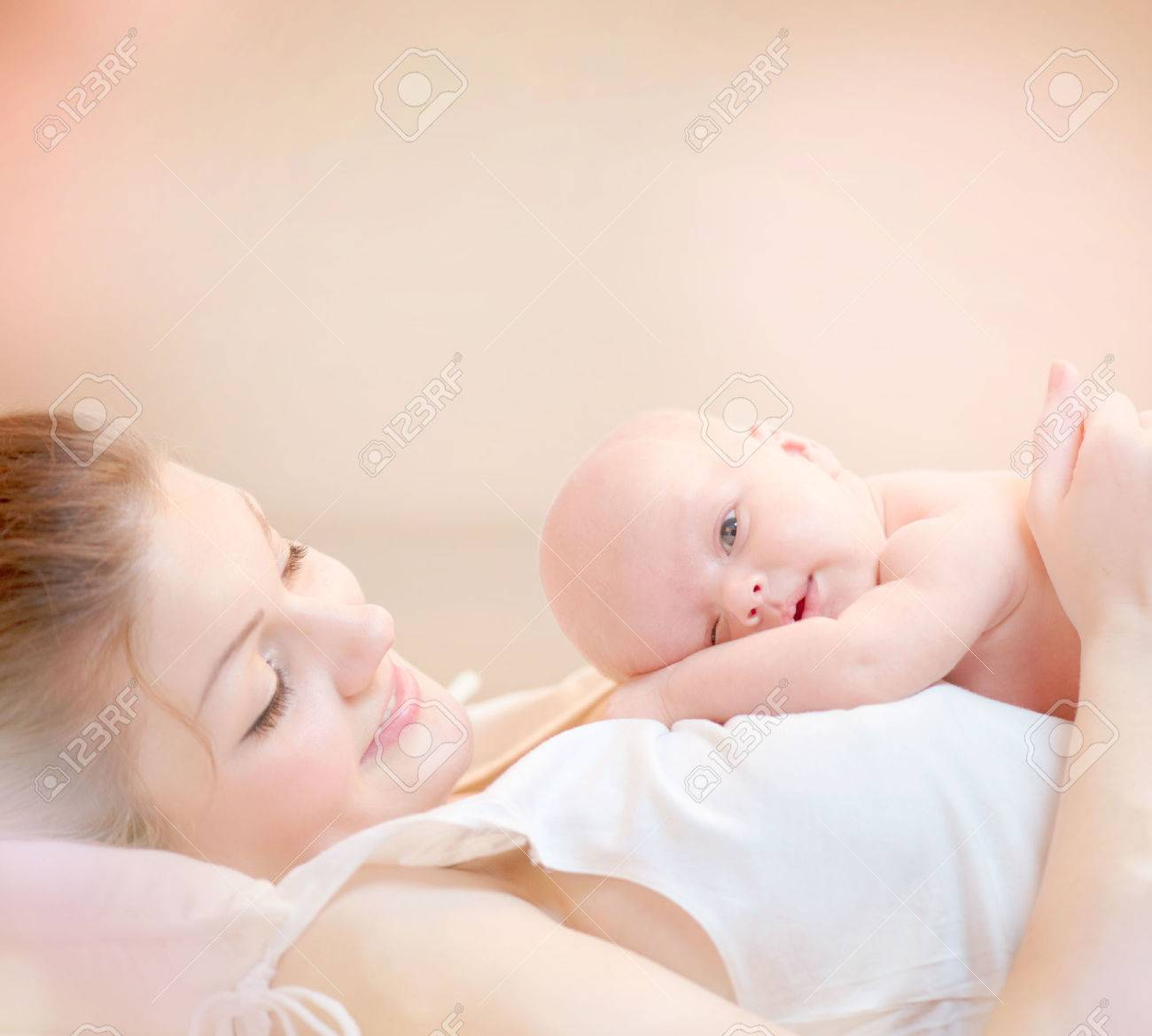 Happy Mother and her Newborn Baby Kissing and hugging Stock Photo - 25227234