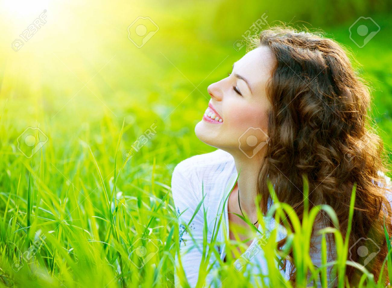 Beautiful Spring Young Woman Outdoors Enjoying Nature - 25594201