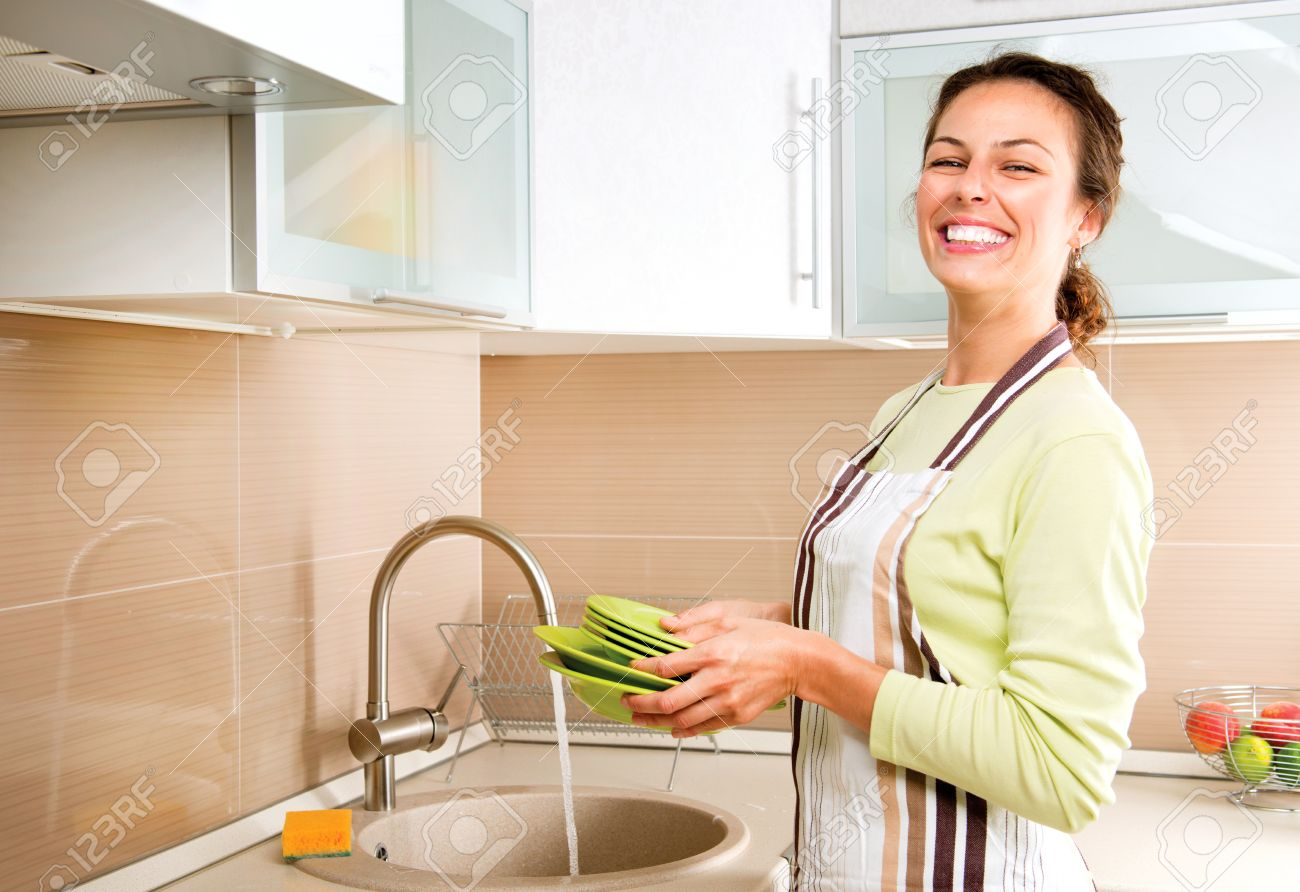 Woman Washing Dishes  Kitchen Stock Photo - 27091279