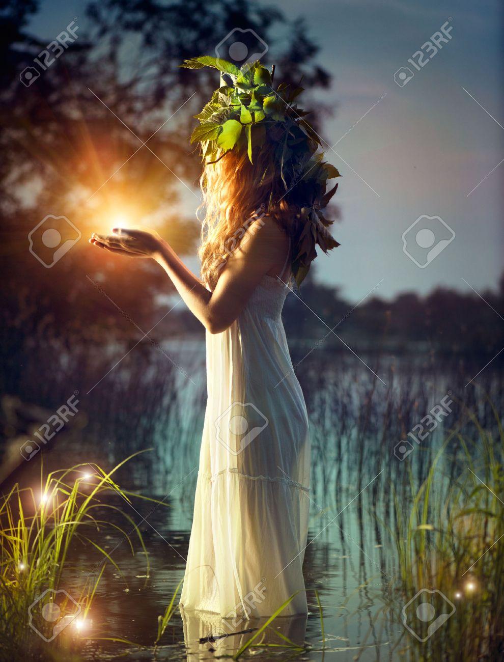 Fantasy girl taking magic light Mysterious night scene - 29096080