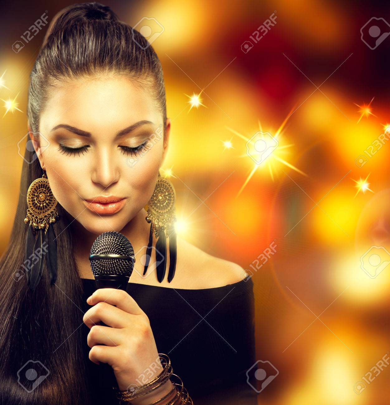 Singing Woman with Microphone over Blinking Background Stock Photo - 29917106