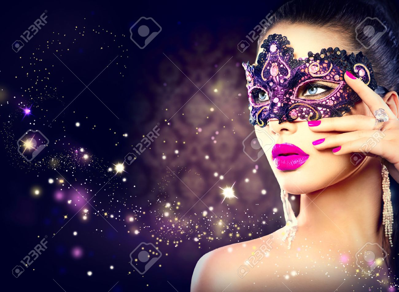 ade2dd1e642d Sexy woman wearing carnival mask over holiday dark background Stock Photo -  34051359