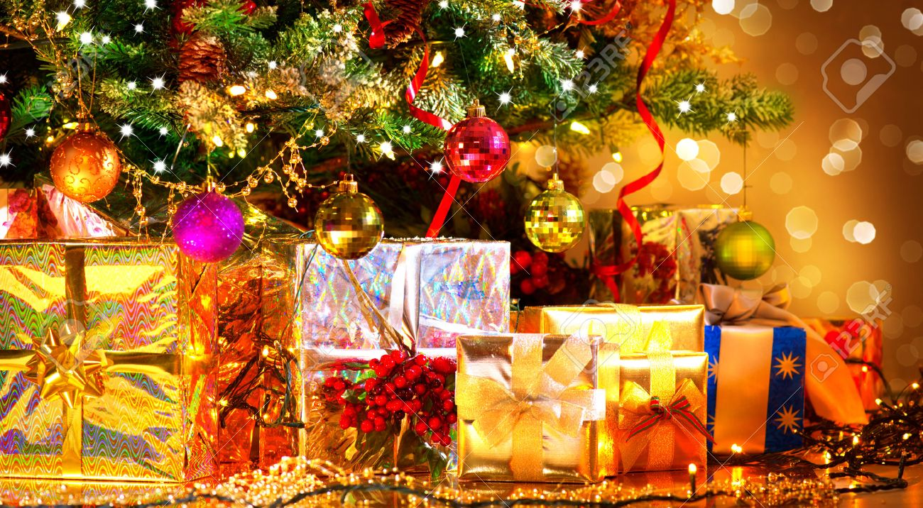 Holiday Christmas Scene. Gifts Under The Christmas Tree Stock Photo ...
