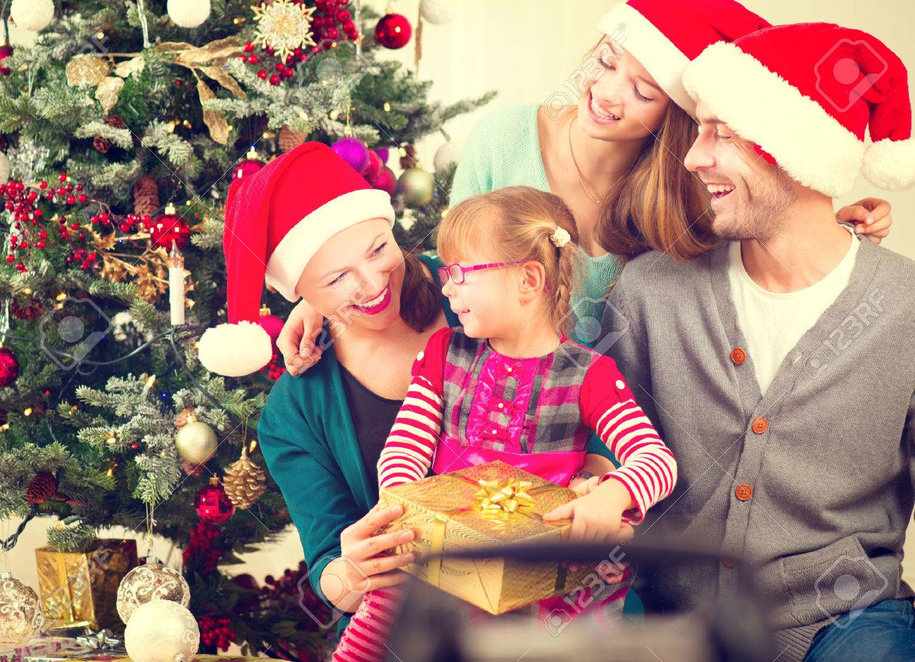 Christmas Family With Kids Opening Christmas Gifts Stock Photo ...