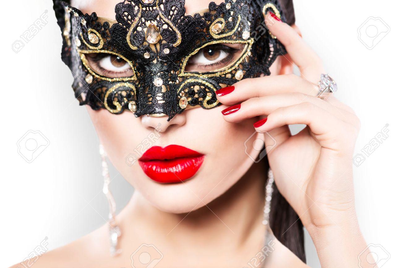 カーニバルの仮面舞踏会マスク身に着けている美容モデル女性 の写真 ...