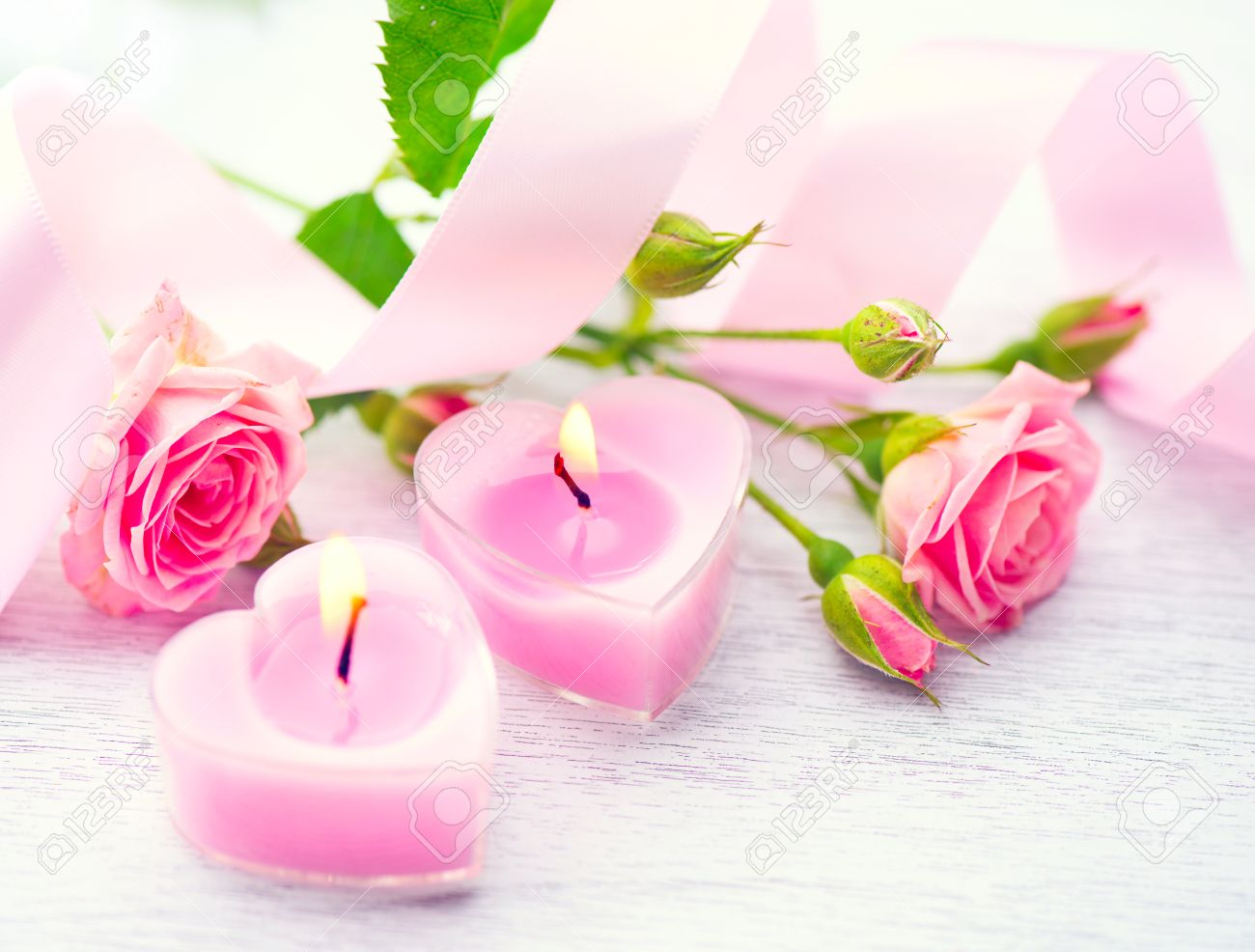 Valentines day pink heart shaped candles and rose flowers stock pink heart shaped candles and rose flowers mightylinksfo