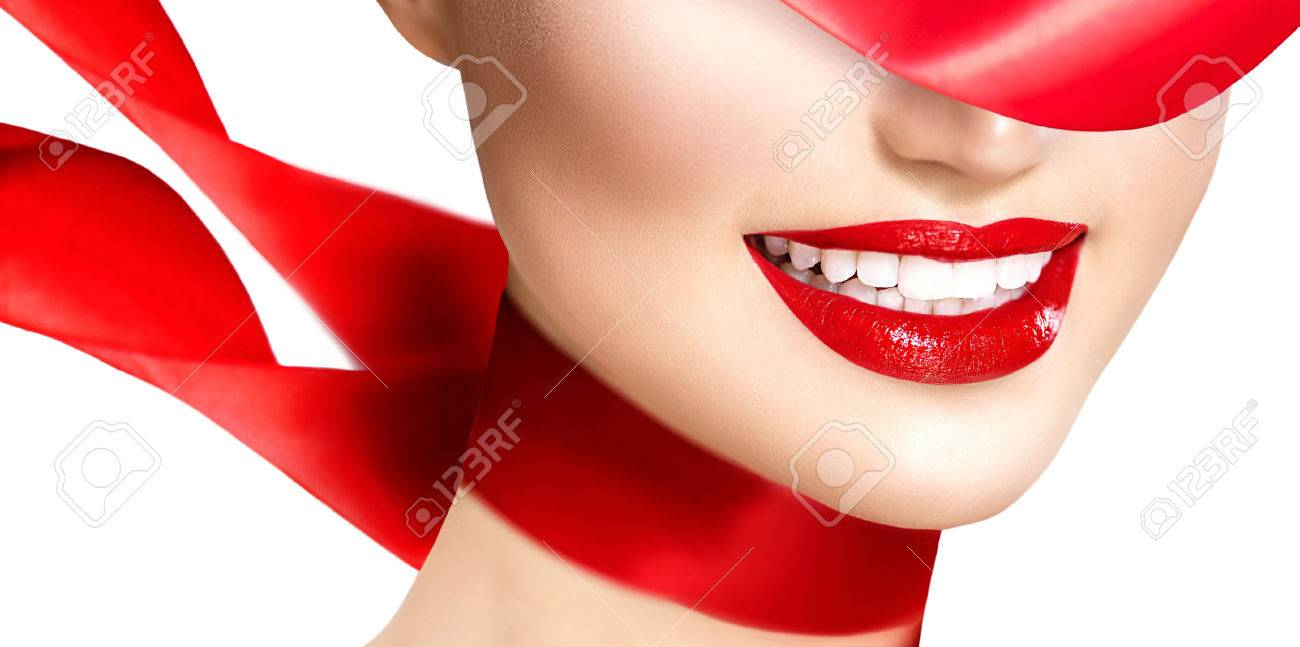 Beautiful model girl with red lips and blowing red silk scarf - 36054728