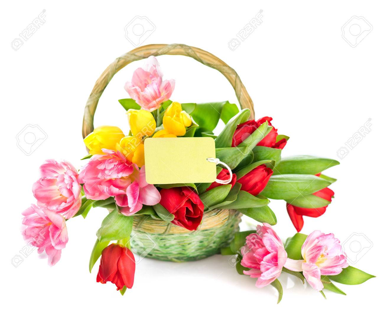Basket Of Spring Holiday Flowers With Greeting Card Stock Photo
