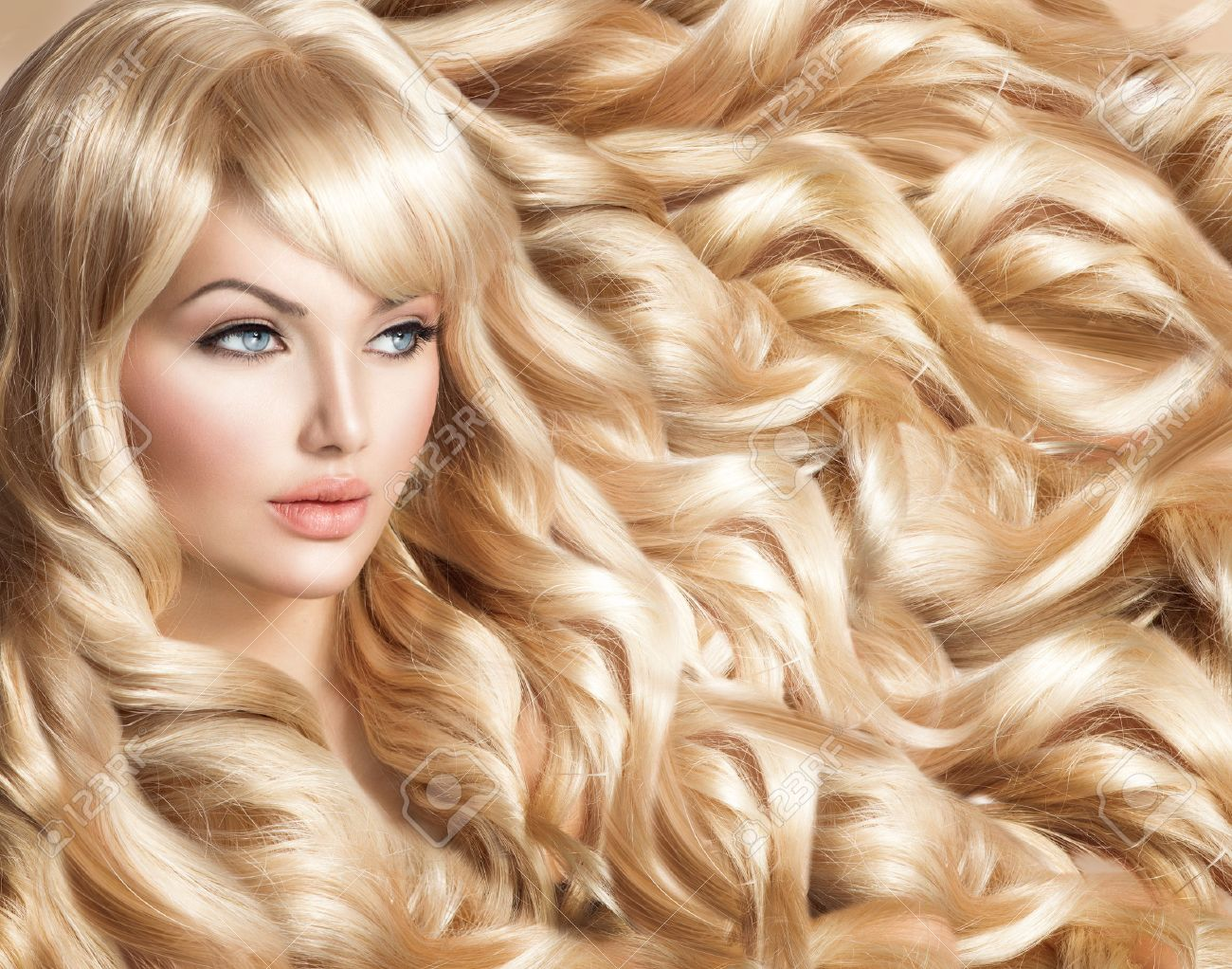 Beautiful Model Girl With Long Curly Blond Hair Stock Photo Picture