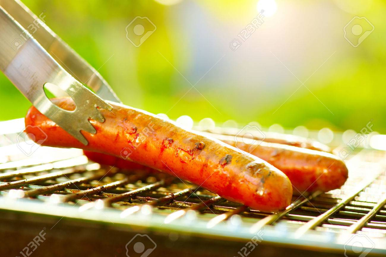 Grilled Sausage on the flaming Grill. Barbecue outdoors. BBQ - 39207572