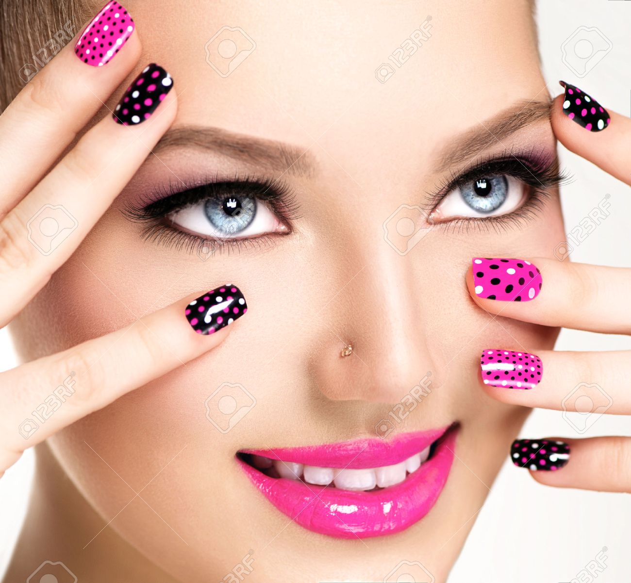 Woman portrait close up. Bright Colors. Manicure and makeup Stock Photo - 39944243