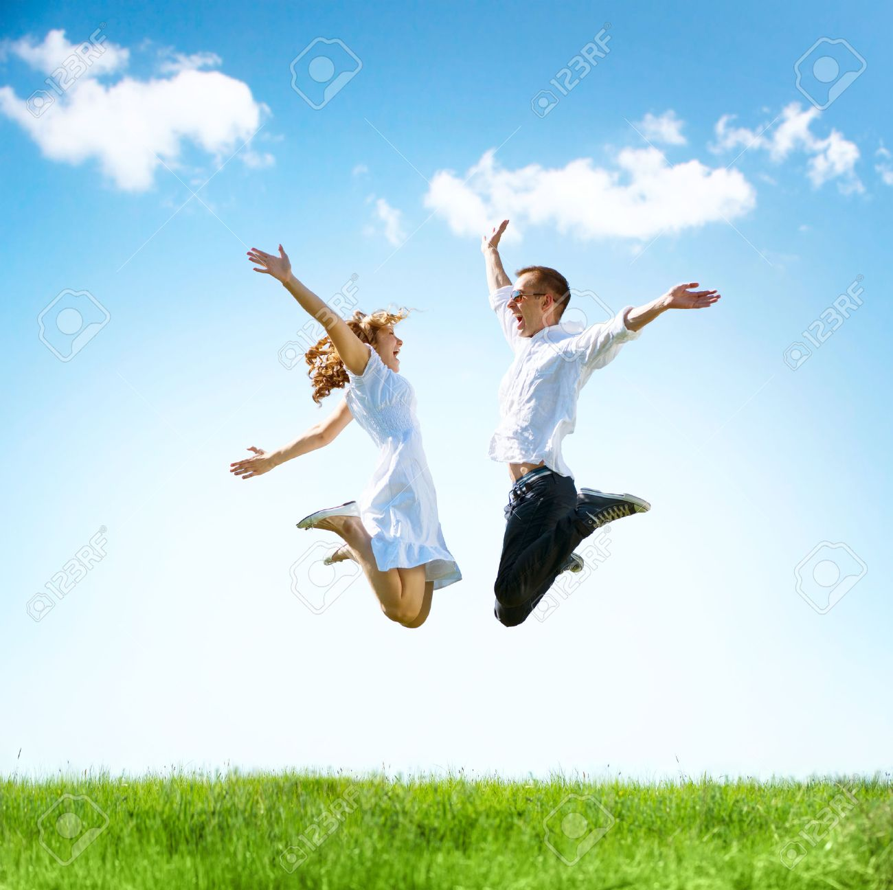Happy couple outdoor. Jumping family on green field - 40186576