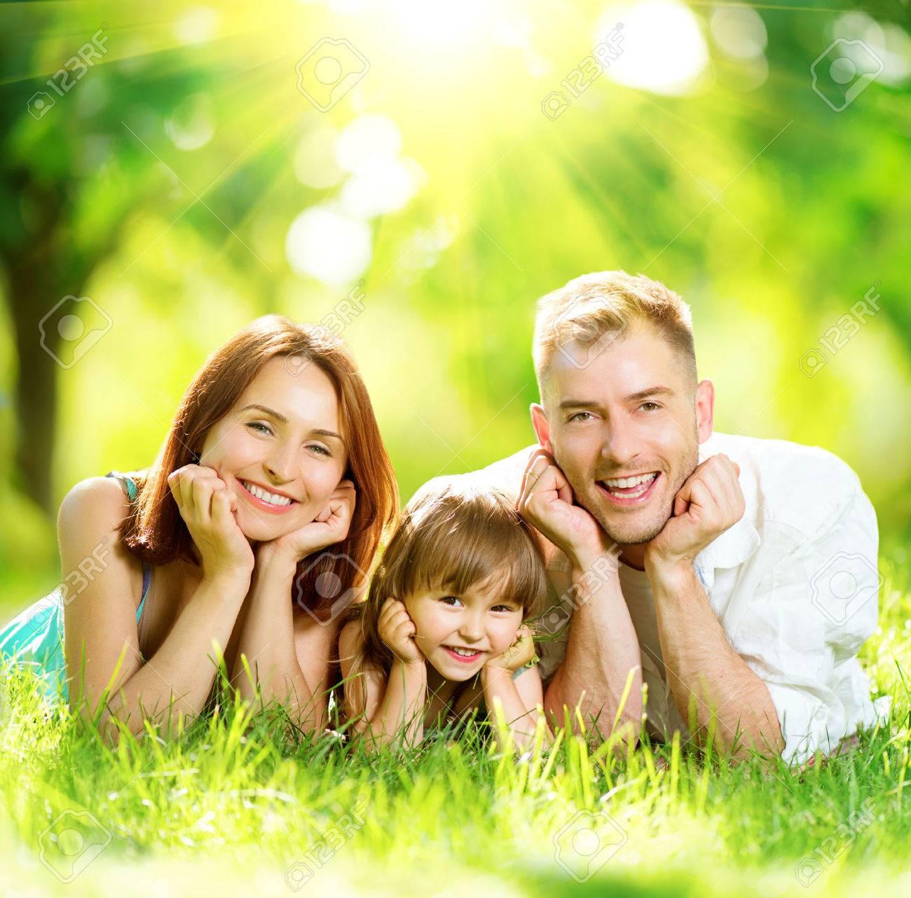 Happy joyful young family having fun in summer park - 41032593