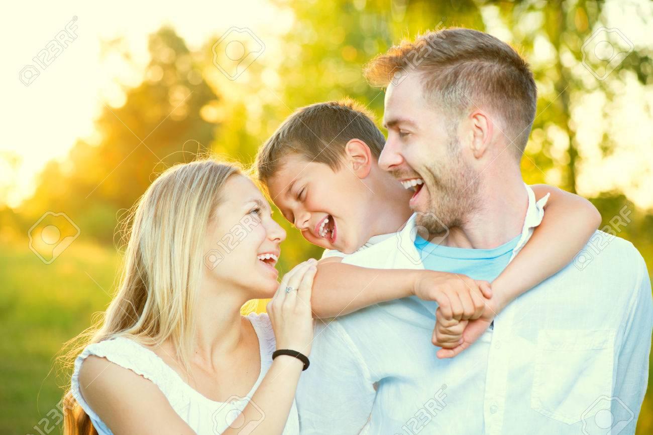 Happy joyful young family having fun outdoors Stock Photo - 41225431
