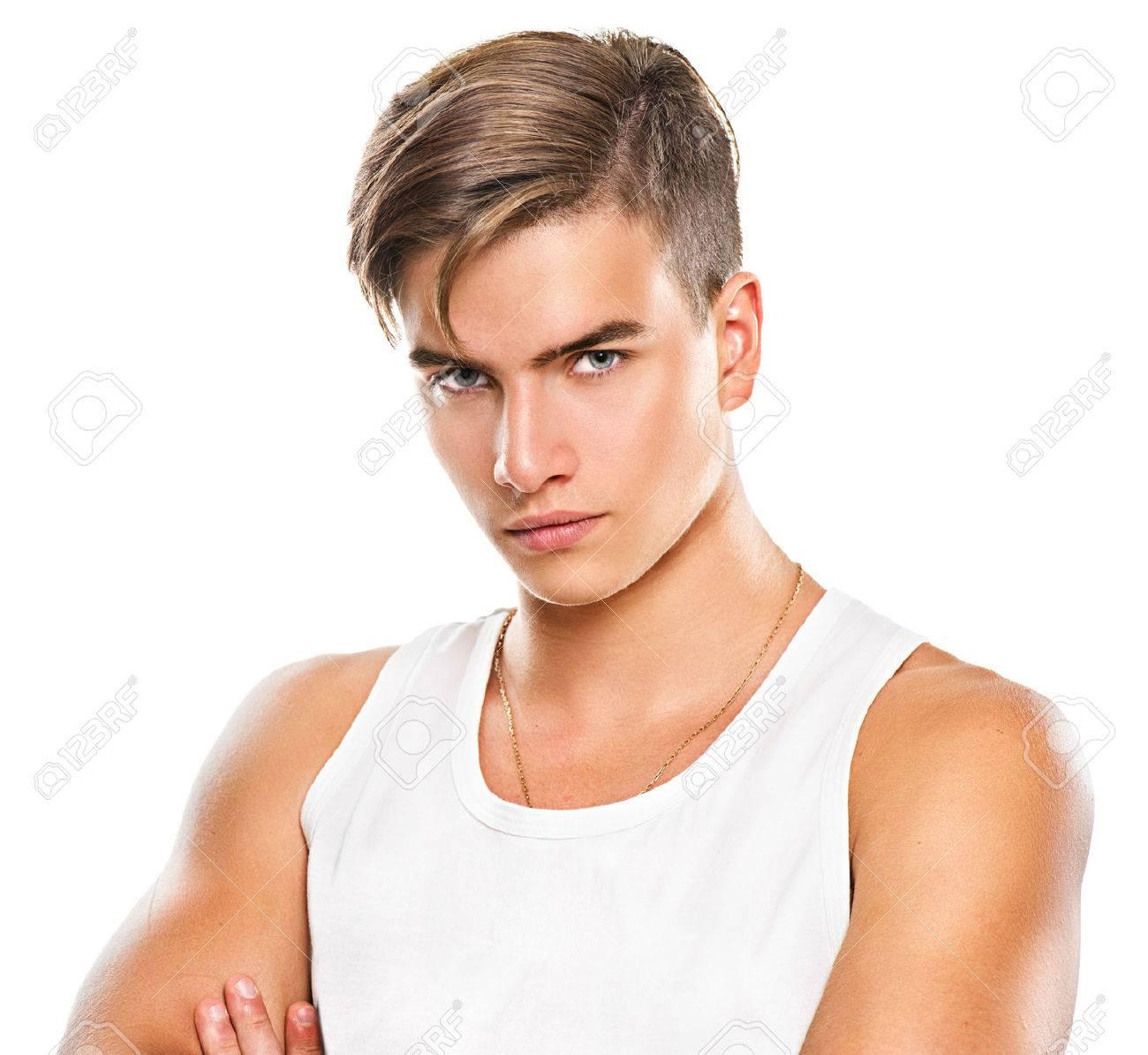 Beau Jeune Homme beau jeune homme athlétique isolé sur fond blanc banque d'images et