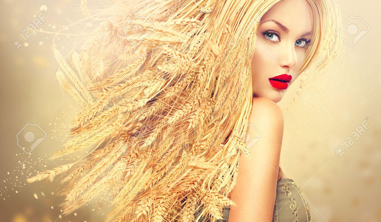 Beauty fashion model girl with gold long wheat ears hair Stock Photo - 43062773