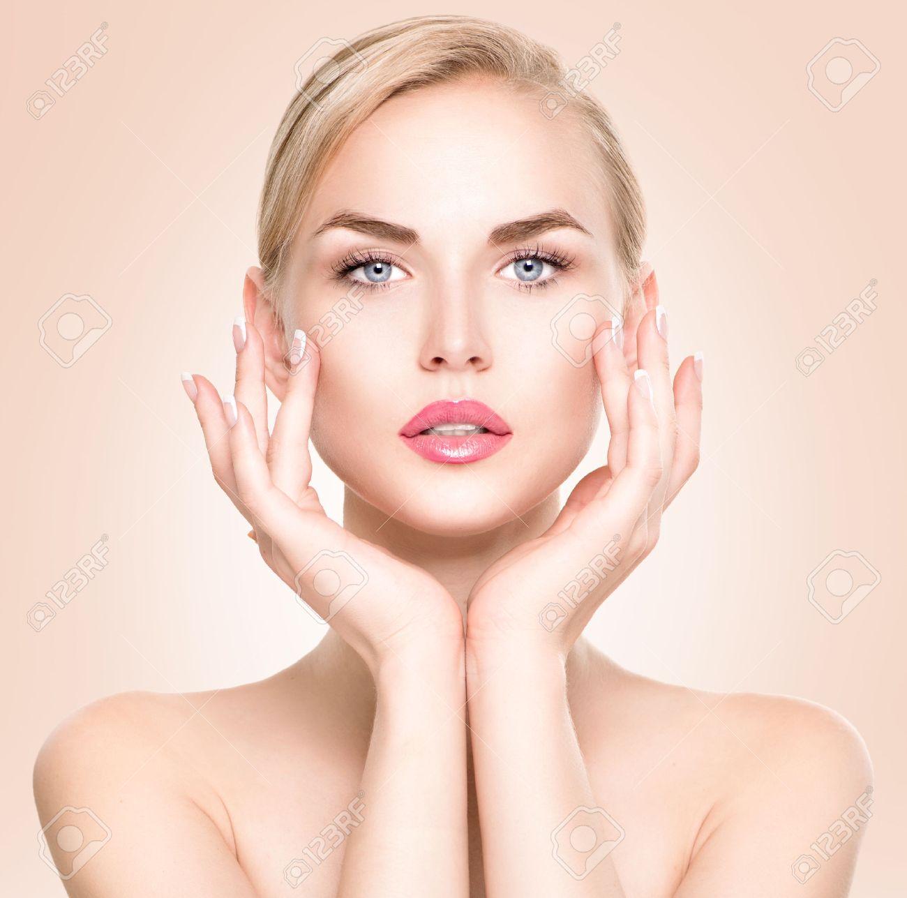 Beauty woman portrait beautiful spa girl touching her face stock photo 43879411
