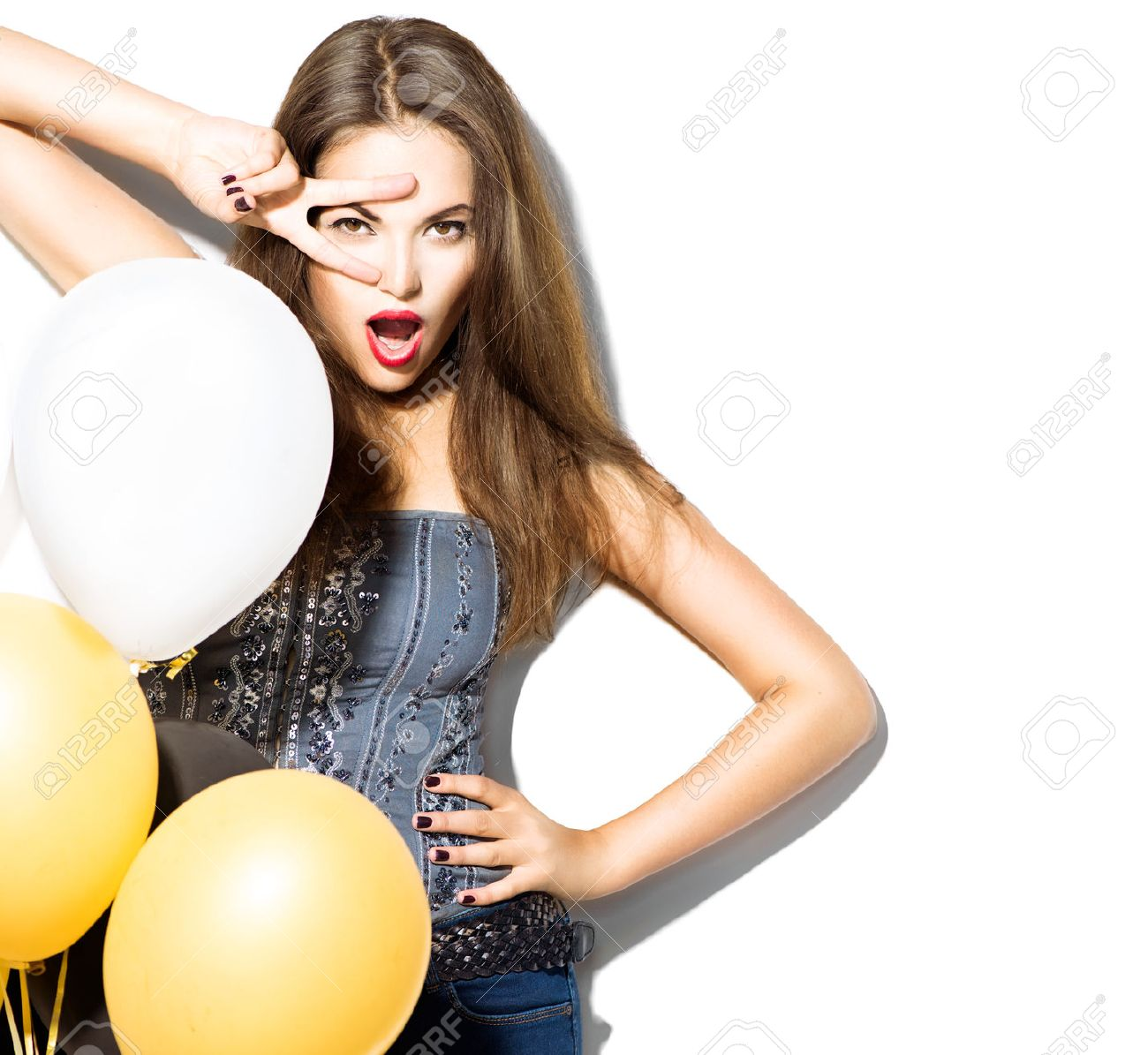 Beautiful fashion model girl with colorful balloons posing over white Stock Photo - 46445776