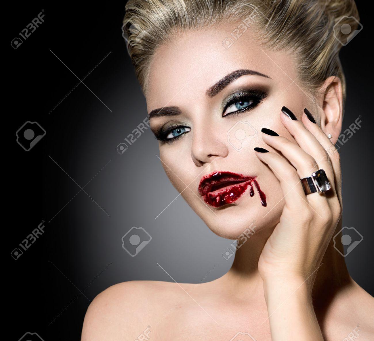 Halloween. Beautiful sexy girl with Vampire makeup