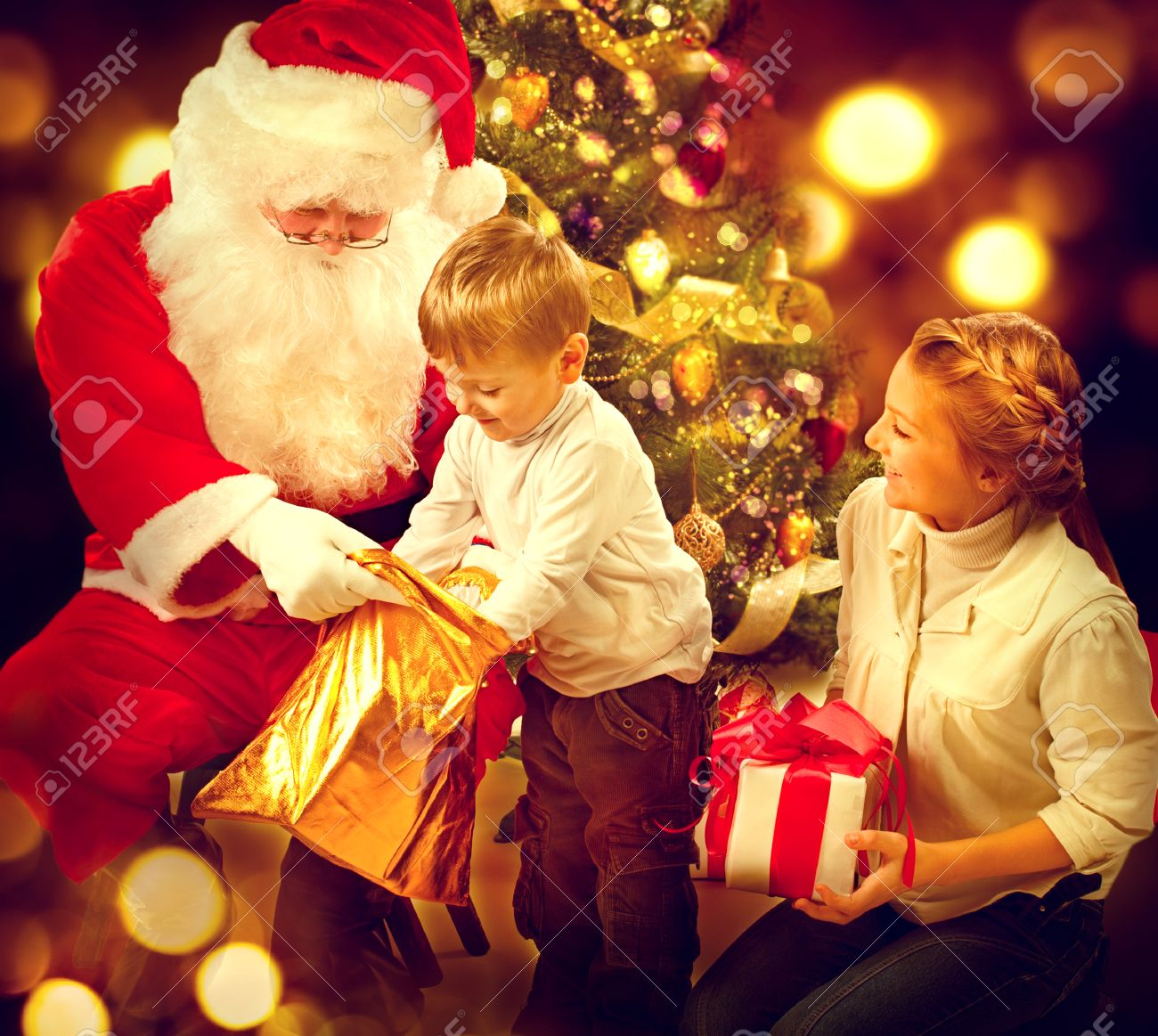 Santa Claus Giving Christmas Gifts To Children. Christmas Holiday ...