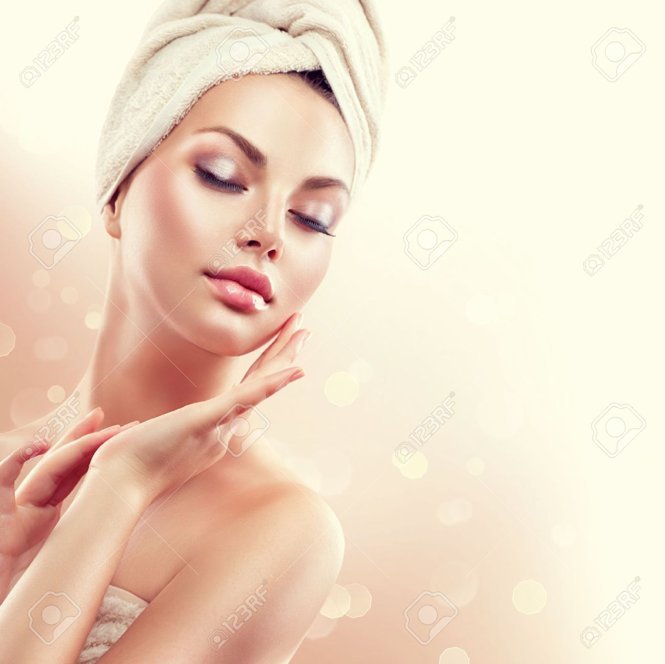 Spa woman. Beautiful girl after bath touching her face Stock Photo - 48318534