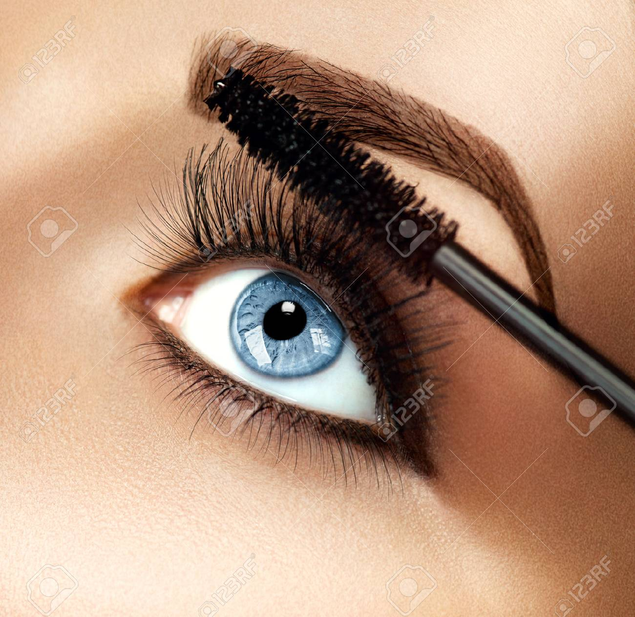 ae56d492189 Mascara makeup applying closeup. Eyelashes extensions Stock Photo - 48843072