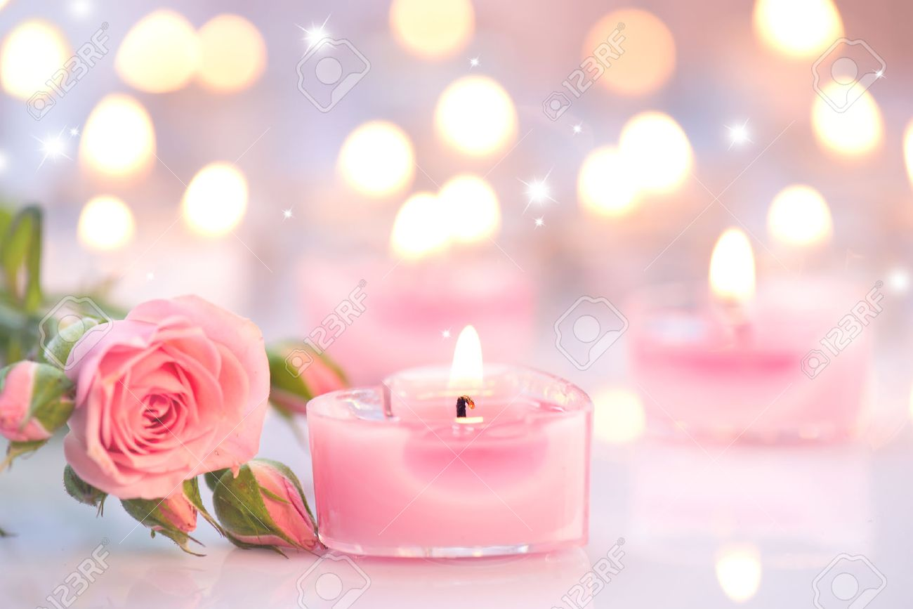 Valentines Day Pink Heart Shaped Candles And Rose Flowers Stock