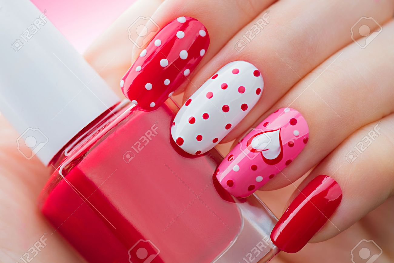 Valentines Day holiday style bright manicure with painted hearts and polka dots - 50758753