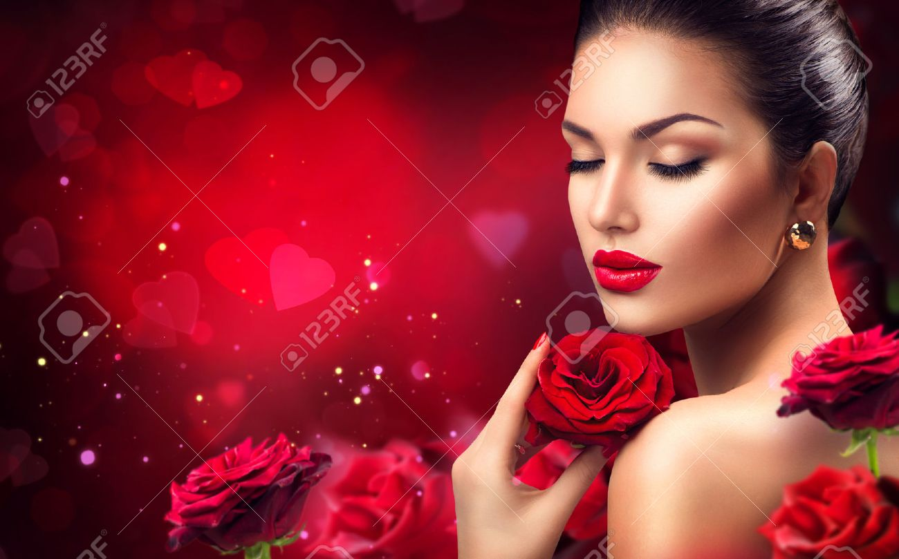 Beauty romantic woman with red rose flowers. Valentines day Stock Photo - 52157246