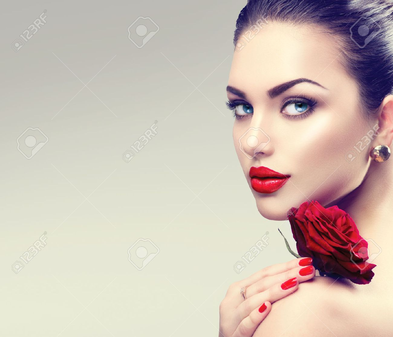 Beauty fashion model woman face. Portrait with red rose flower Stock Photo - 51892338