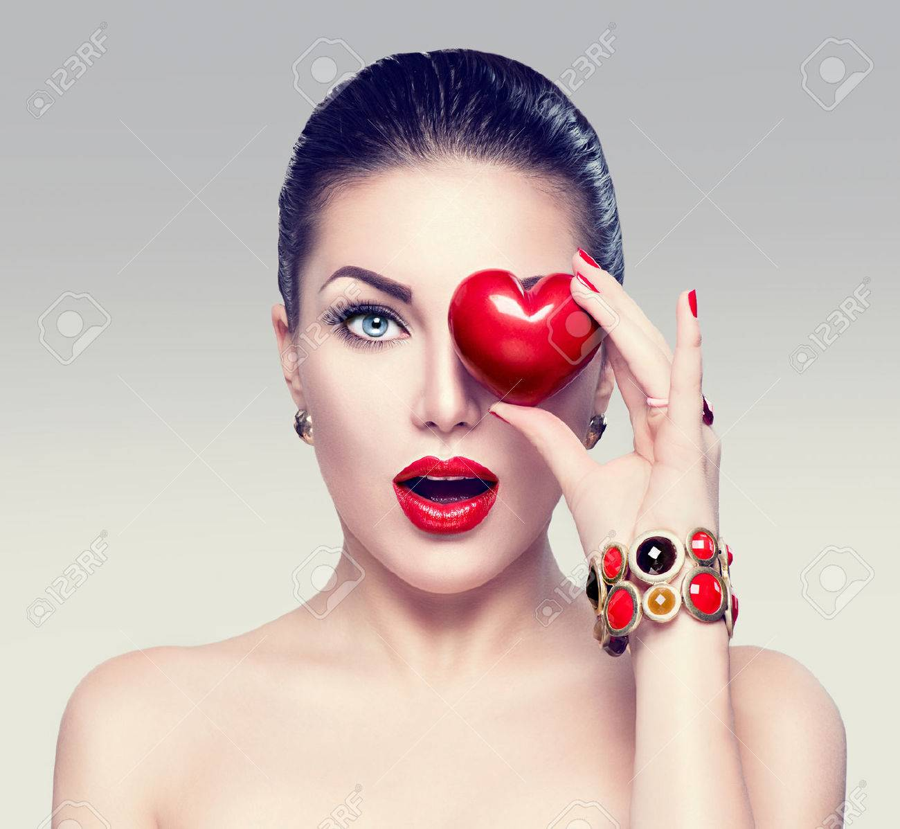 Fashion woman with red heart. Valentine's day art portrait - 51892247