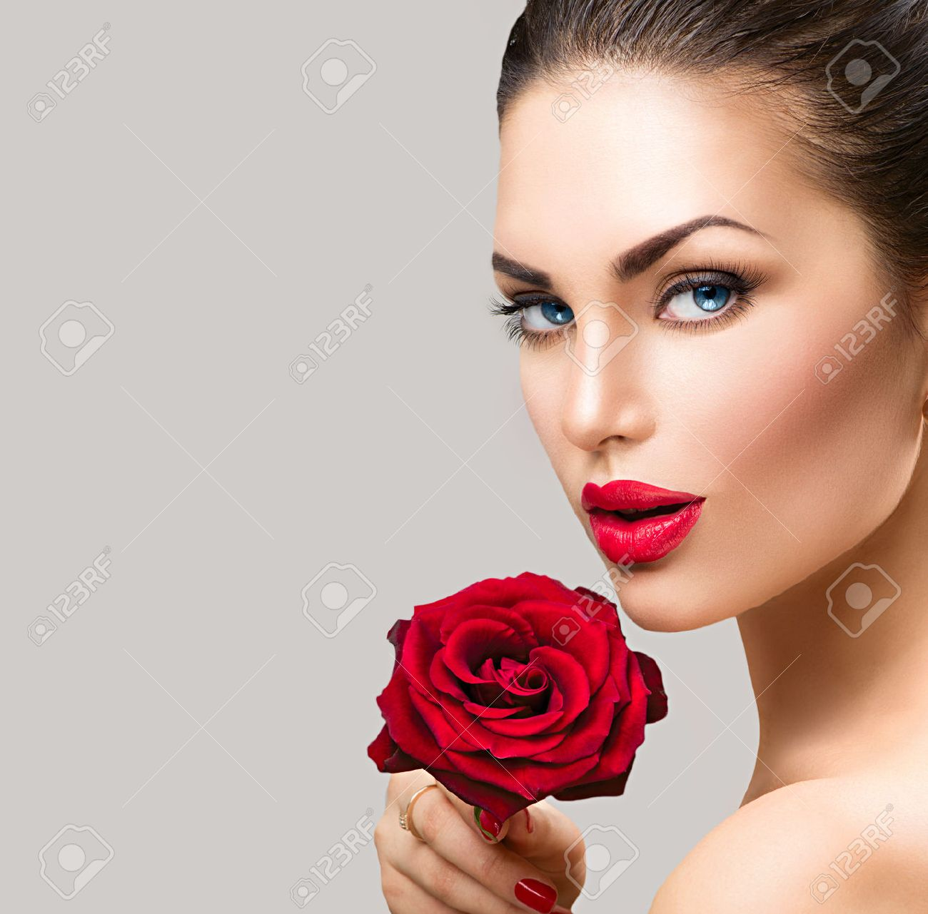 Beauty fashion model woman face. Portrait with red rose flower - 51755920