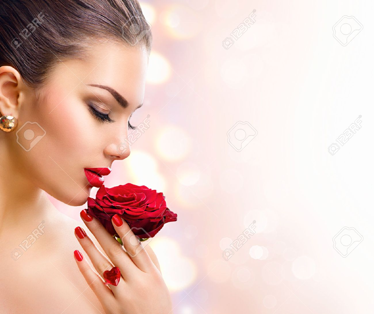 Fashion model girl face portrait with red rose in her hand - 52316179