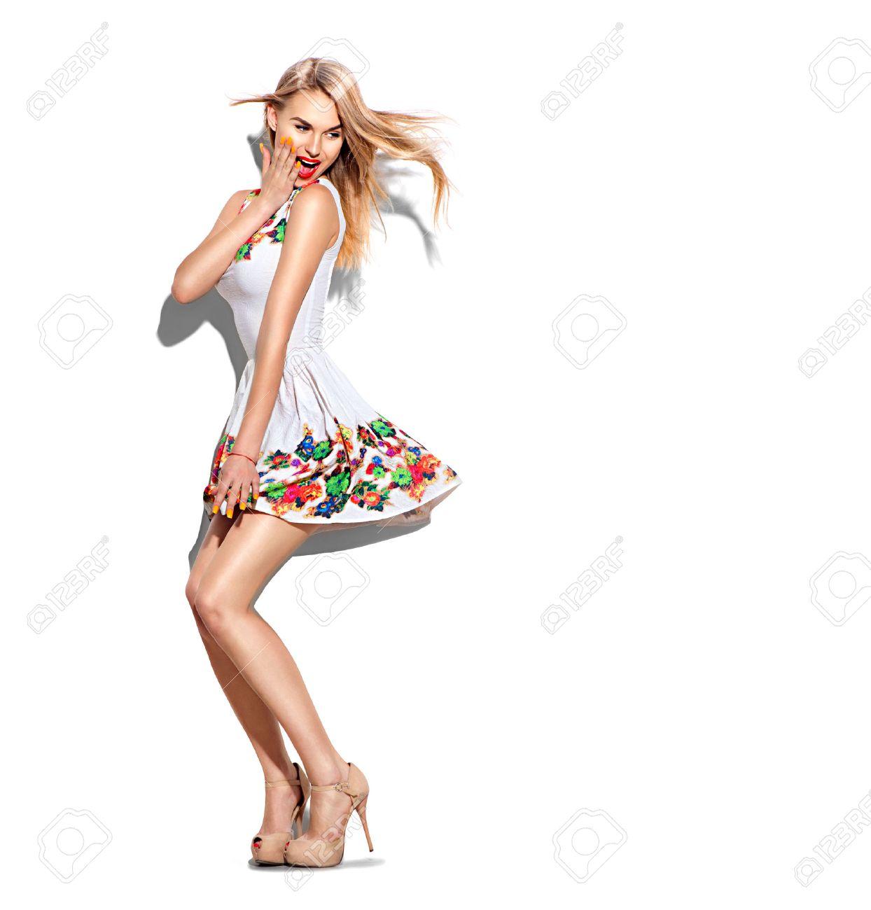 Surprised fashion model girl full length portrait dressed in short white dress - 54898659