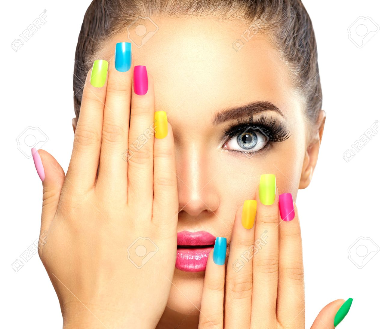 Beauty Girl Face With Colorful Nail Polish. Manicure And Makeup ...