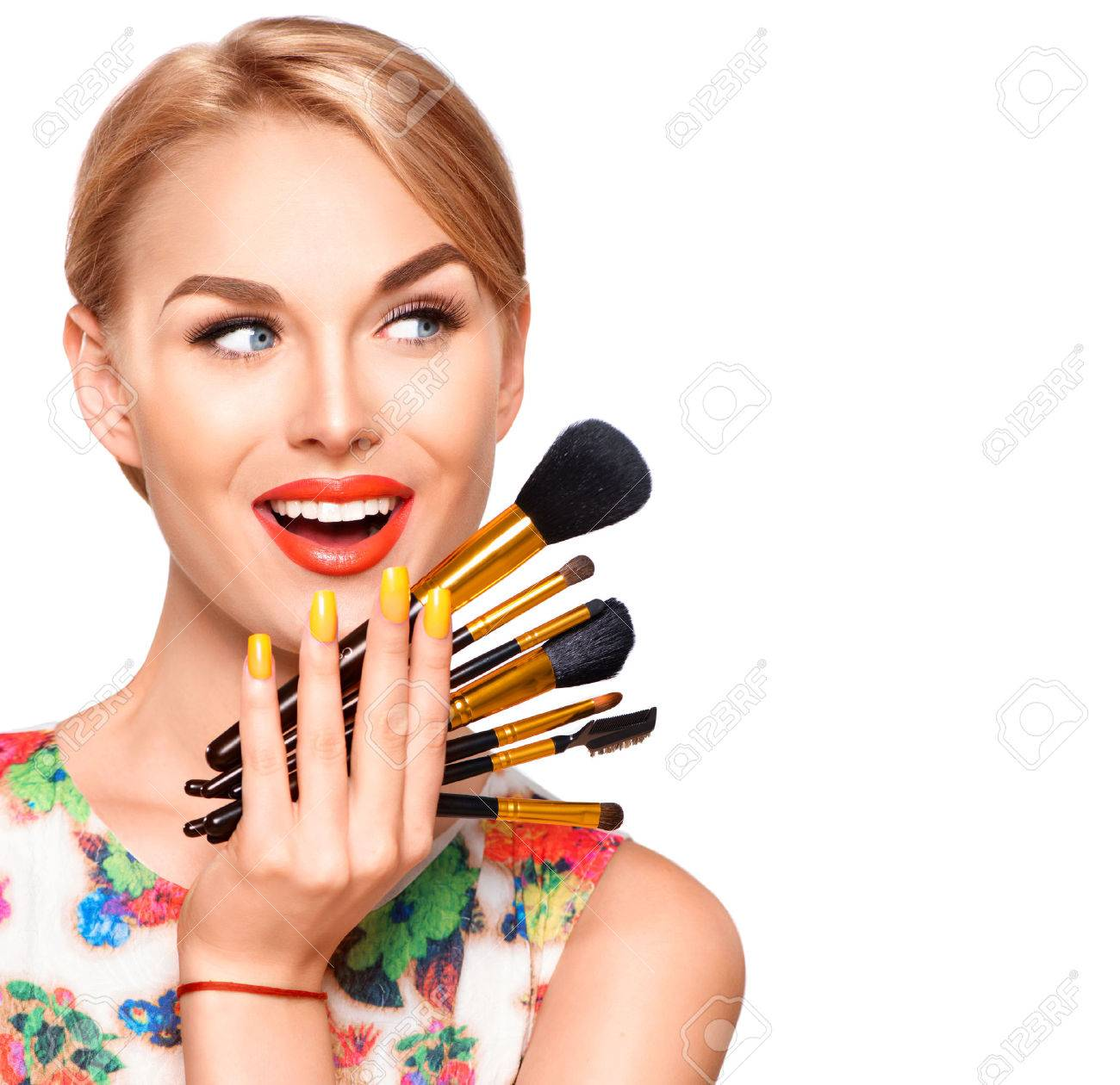 Beauty woman with makeup brushes. Applying holiday makeup - 55256201