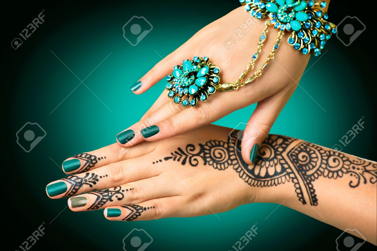 Woman\'s hands with mehndi tattoo. Hands of Indian bride girl..