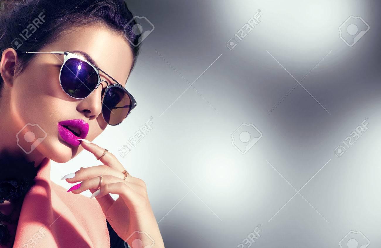Sexy model girl wearing stylish sunglasses - 61789359