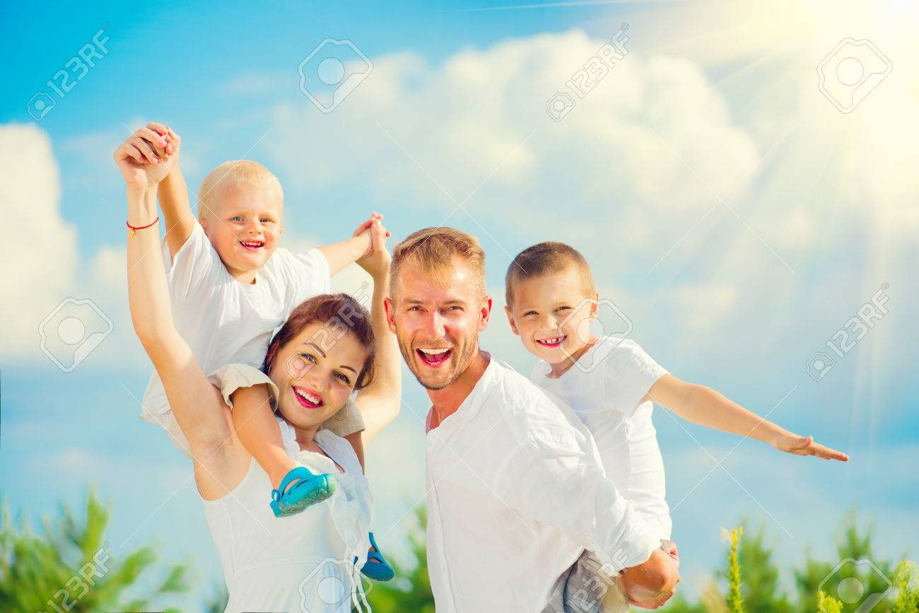 26211be5d75 Happy young family with two children having fun together Stock Photo -  61732165