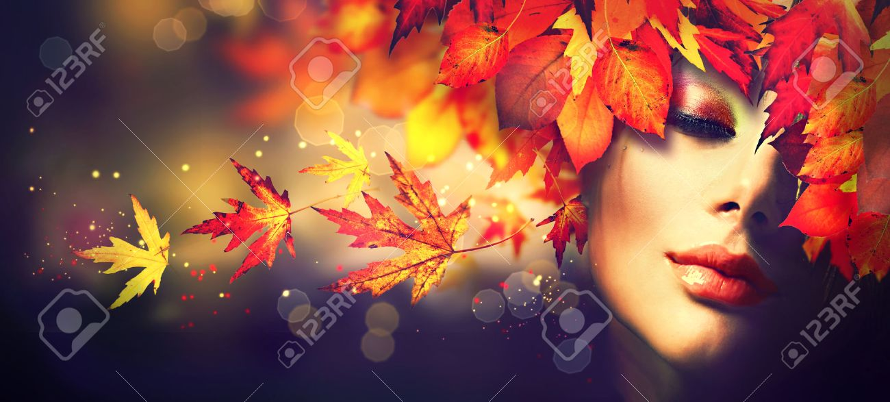 Fall. Beauty model girl with colourful autumn leaves hairstyle - 62203134