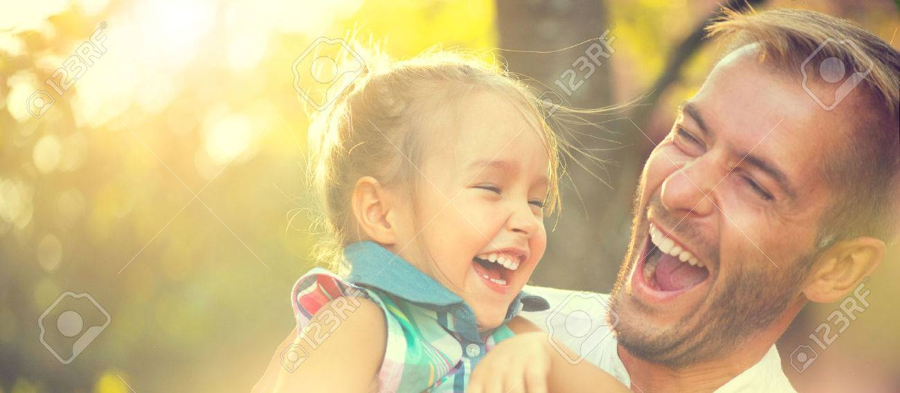 Happy joyful young father with his little daughter - 62172132